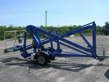 Used towable boom lift attached to a trailer hitch