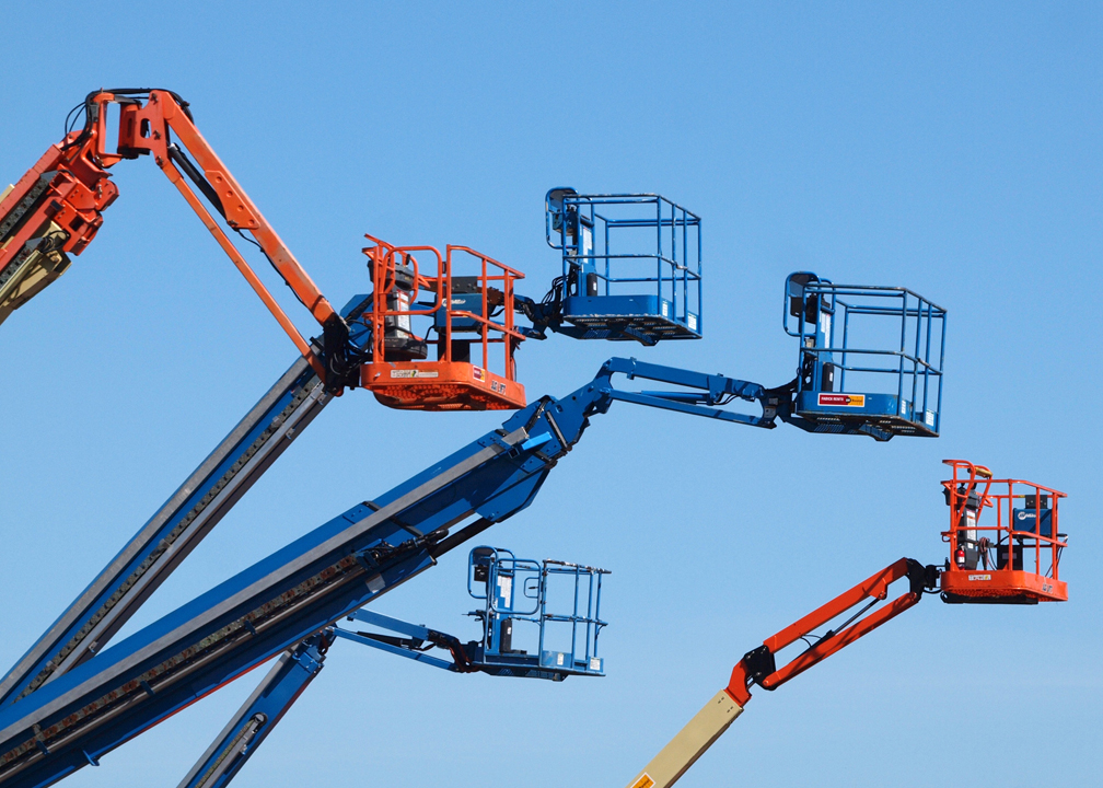 Aerial boom lifts with platforms extended