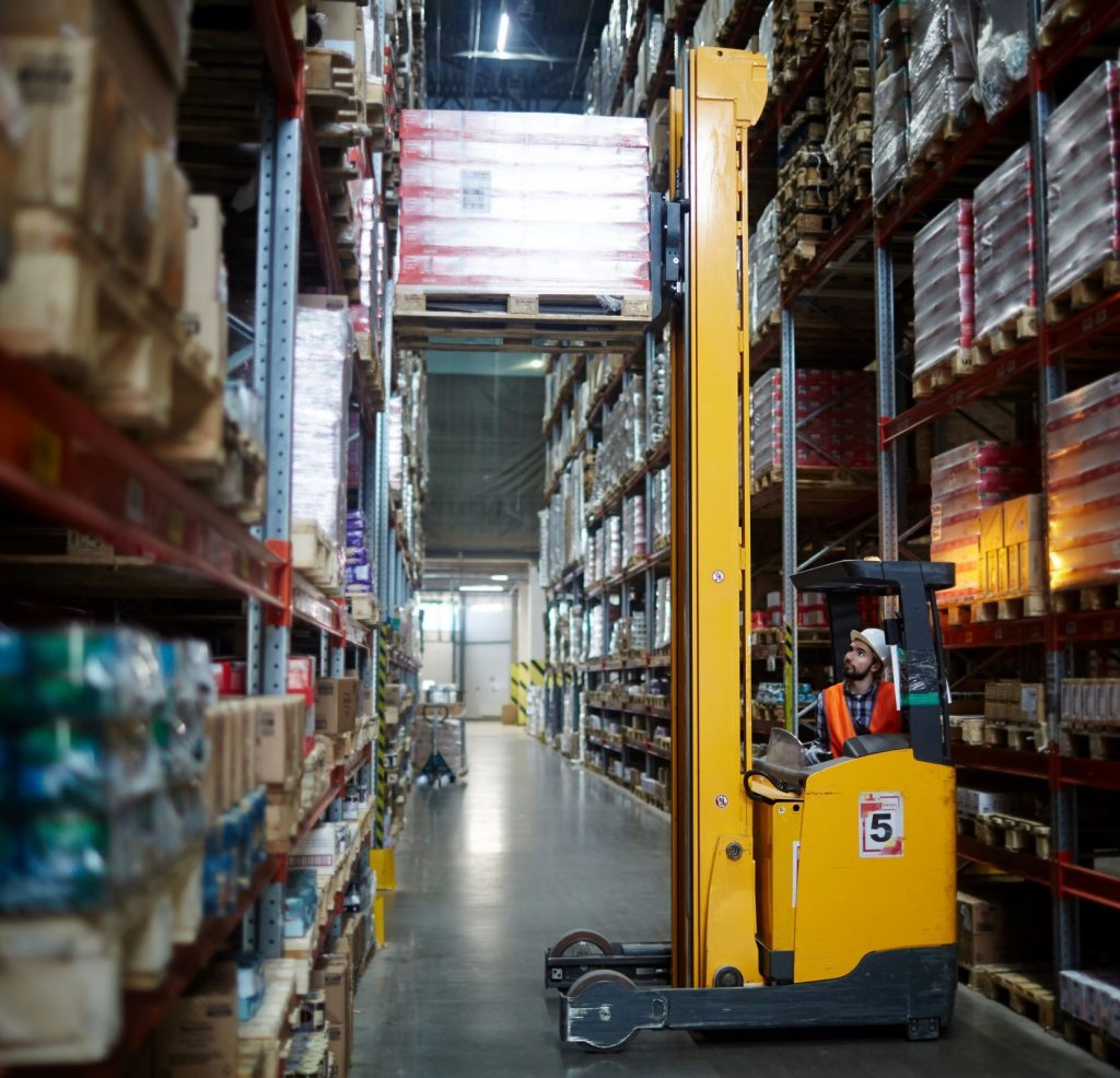 Forklift operator following OSHA warehouse safety guidelines
