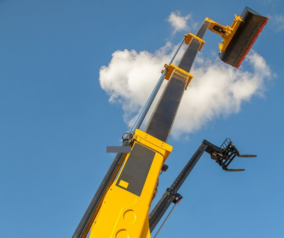 Multiple straight boom lifts outside