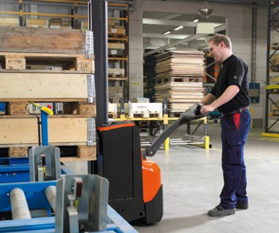 Small walkie stacker being used in a warehouse