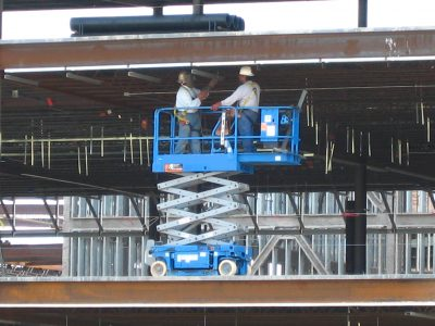 Small electric scissor lift used for building repairs