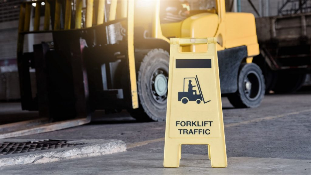 Warehouse forklift operated per OSHA forklift safety rules