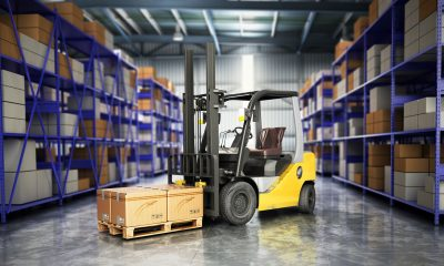 Counterbalance forklift with smooth cushion tires in a warehouse