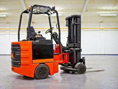 Cushion tire forklift in an empty warehouse