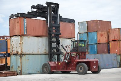 Top pick forklift transporting cargo