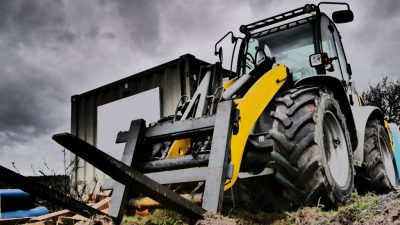 Large construction forklift outside in the mud