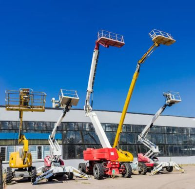 Various sizes of articulating boom lifts for sale outside