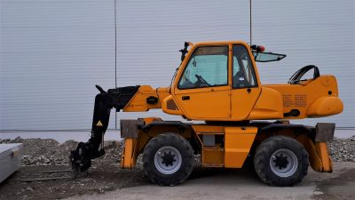 Orange terrain forklift outside