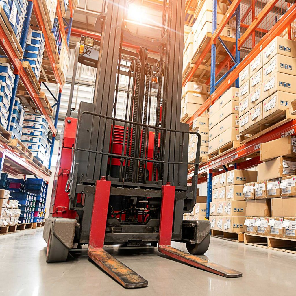 Warehouse forklift operated by a worker with an OSHA forklift certification
