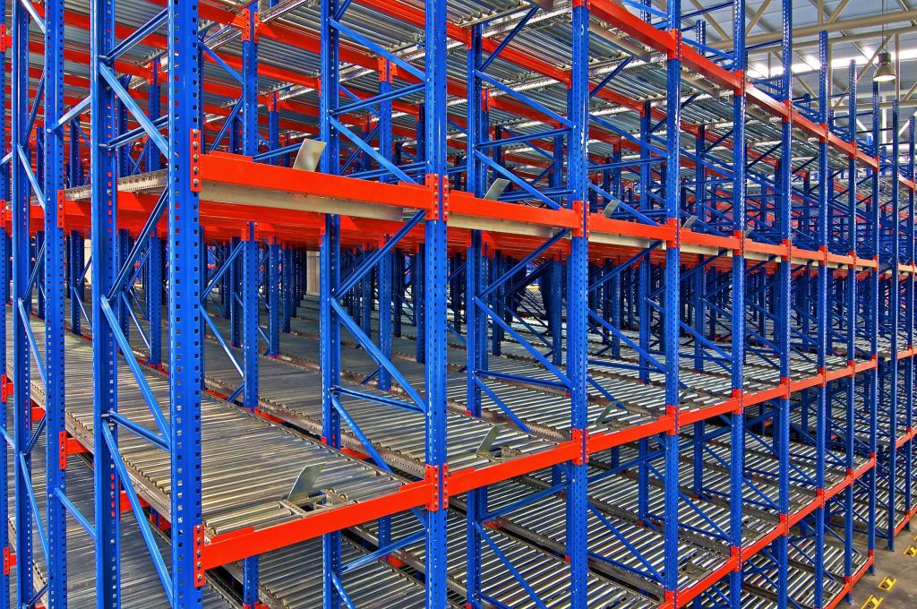 Carton flow racking with slanted rails inside a warehouse