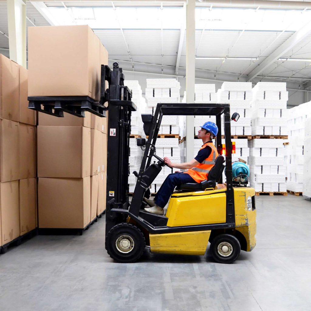 Forklift operator lifting a load within forklift weight capacity