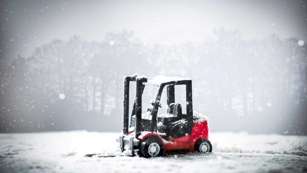 Red forklift from Forklift Inventory in the snow