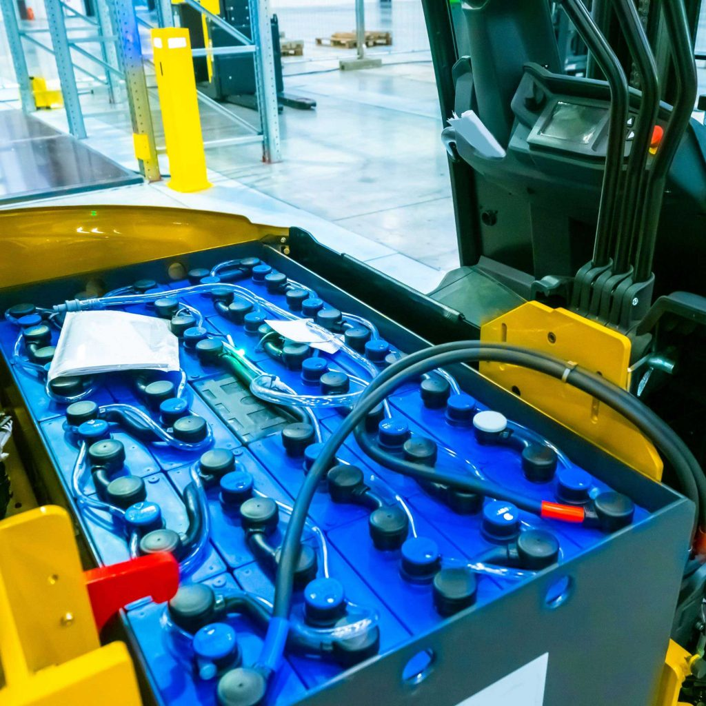 The exposed battery of an electric forklift truck