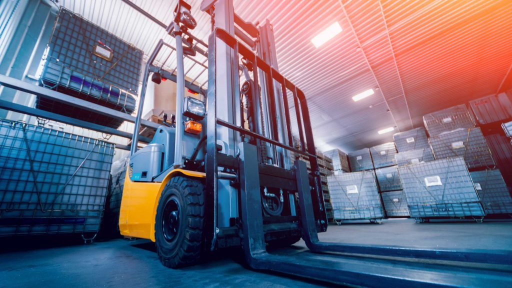 Yellow warehouse forklift with pneumatic tires