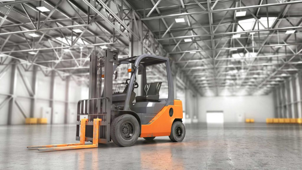 Counterbalance forklift parked in an empty warehouse