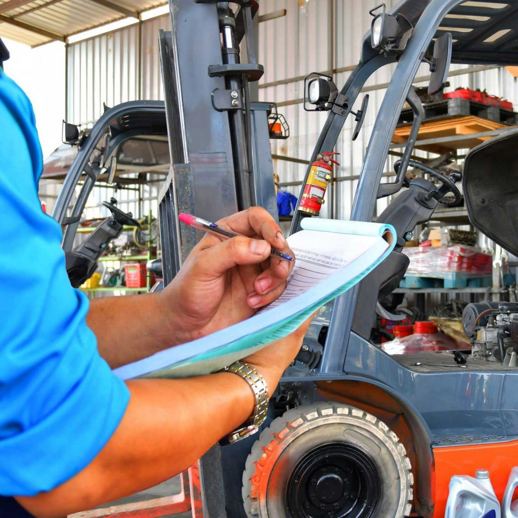 Forklift operator uses maintainice checklist to conduct maintanence  a checklist to conduct forklift maintenance on their outdoor machine this spring.