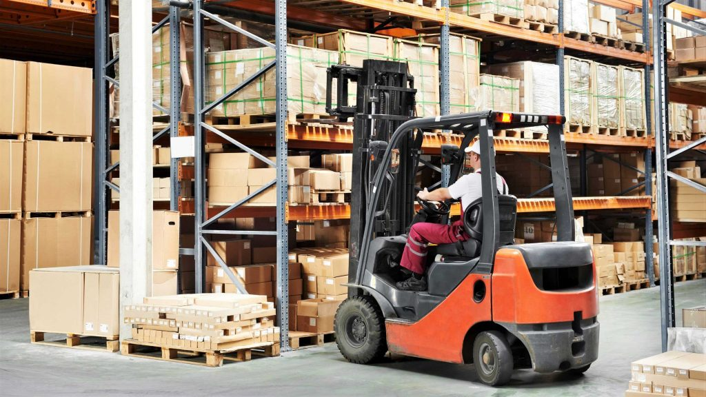 A truck from Forklift Inventory following OSHA forklift safety guidelines.