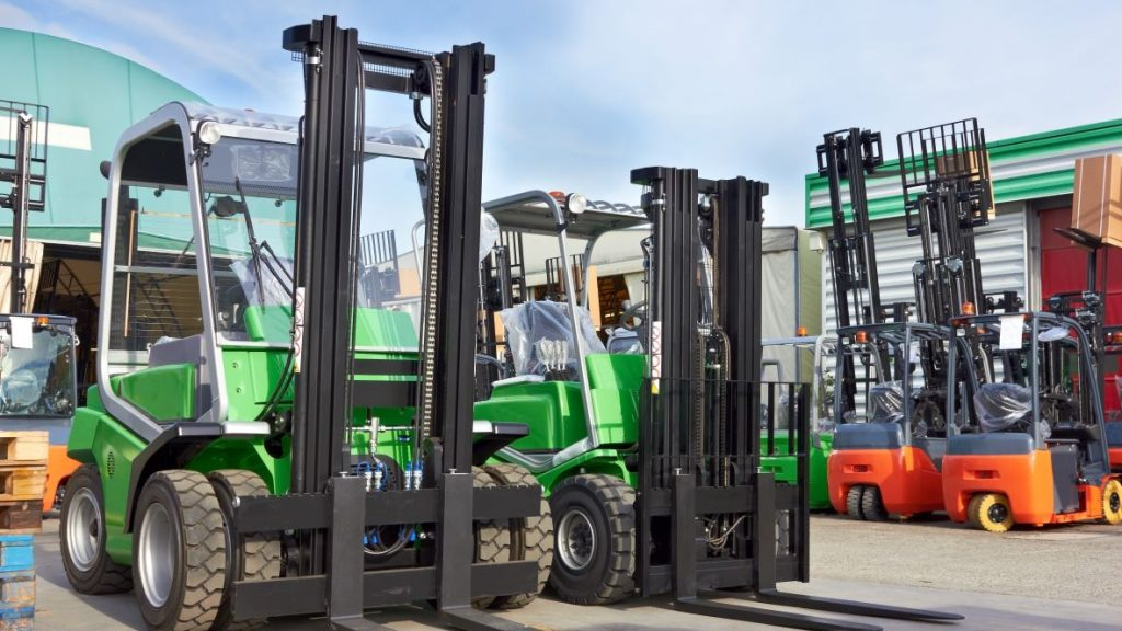 Different types of forklifts from Forklift Inventory in an outdoor warehouse.