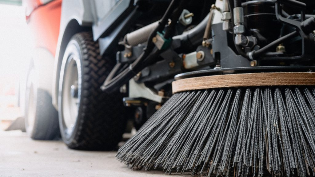 Large floor scrubber brush attached to a disc scrubber head