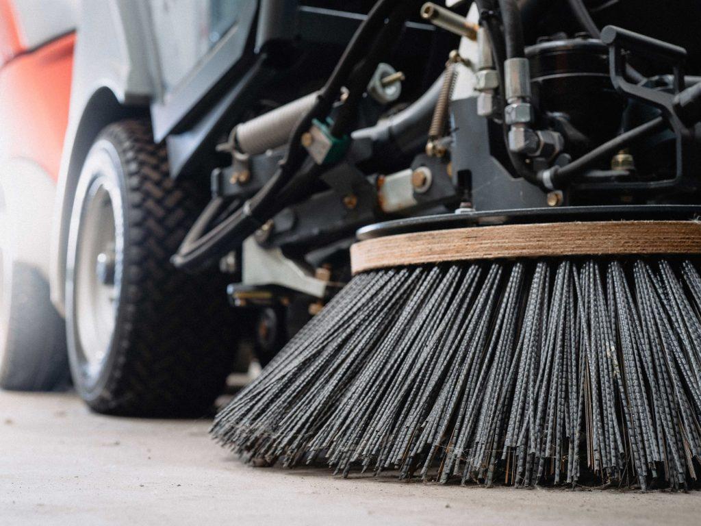 Large bristles on a regenerative air sweeper