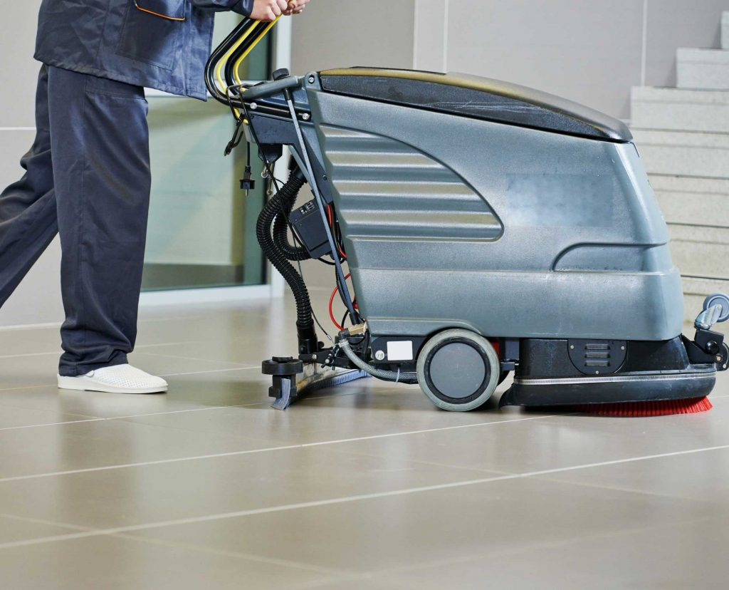 Auto scrubber being used indoors on tile flooring