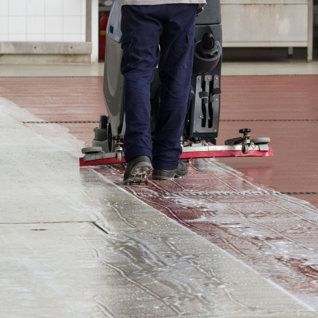 Industrial floor scrubber leaving soap on the ground from detergent