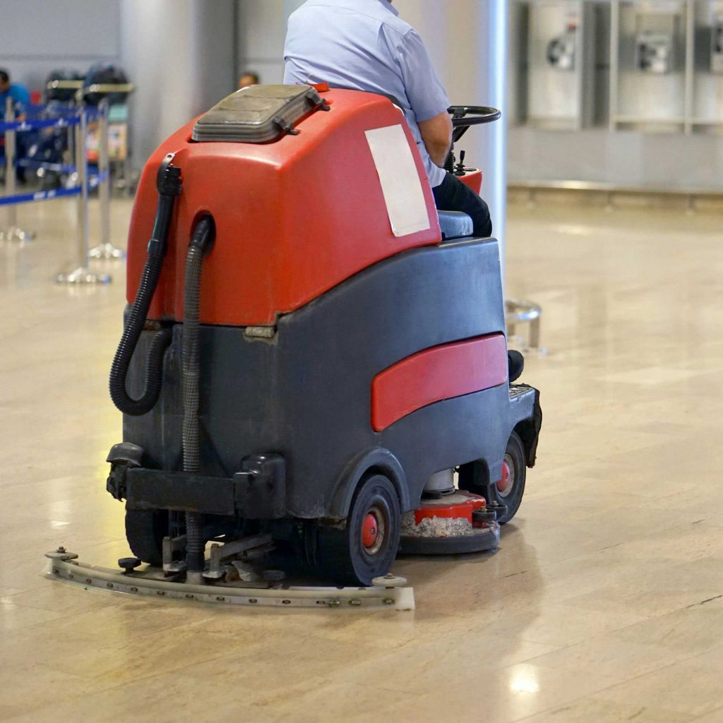 Floor scrubber operator learning how to use the cleaning equipment