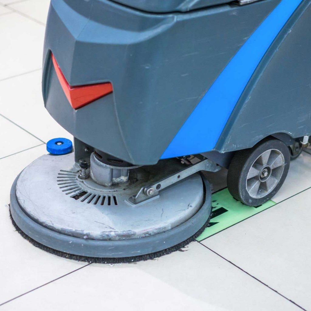 Your best floor scrubber might look like this commercial floor scrubber, which is gray and cleaning a mall floor.