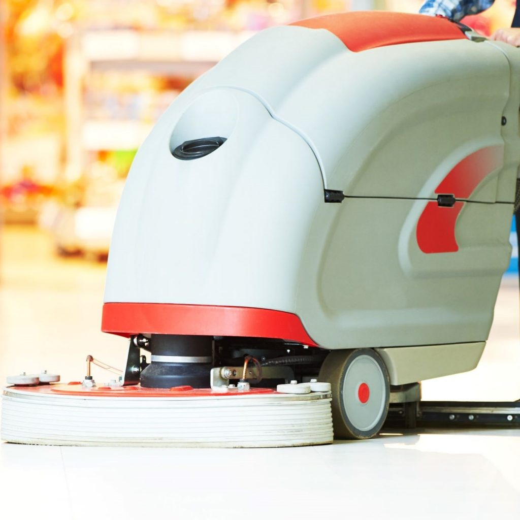 A tile scrubber machine functioning as a restaurant floor scrubber.