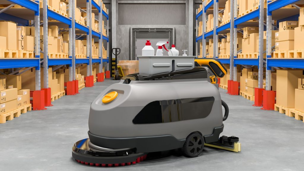 An electric floor scrubber in a warehouse cleaning and drying its path.