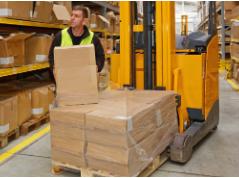 Narrow aisle reach truck in a warehouse
