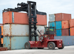 Loaded container handler stacking cargo